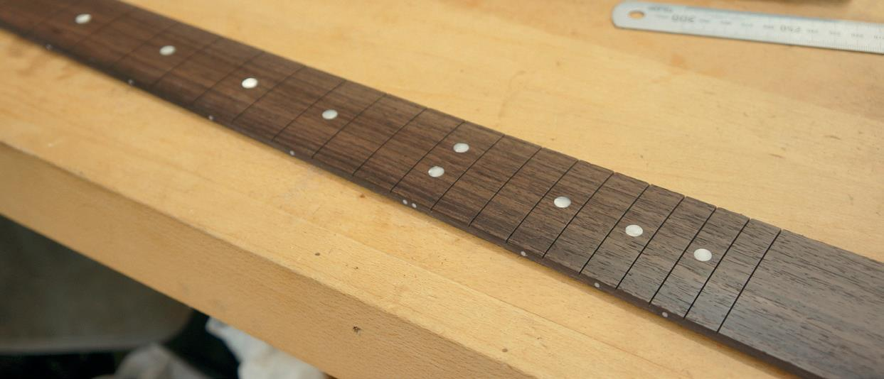 Rosewood fingerboard and dots positioned and sanded