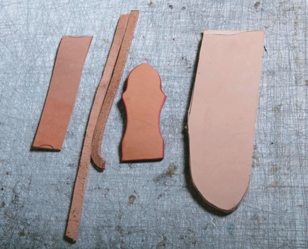 Leather pieces for (from left) sleeve for the steel, spacer strips, belt loop, sheath.