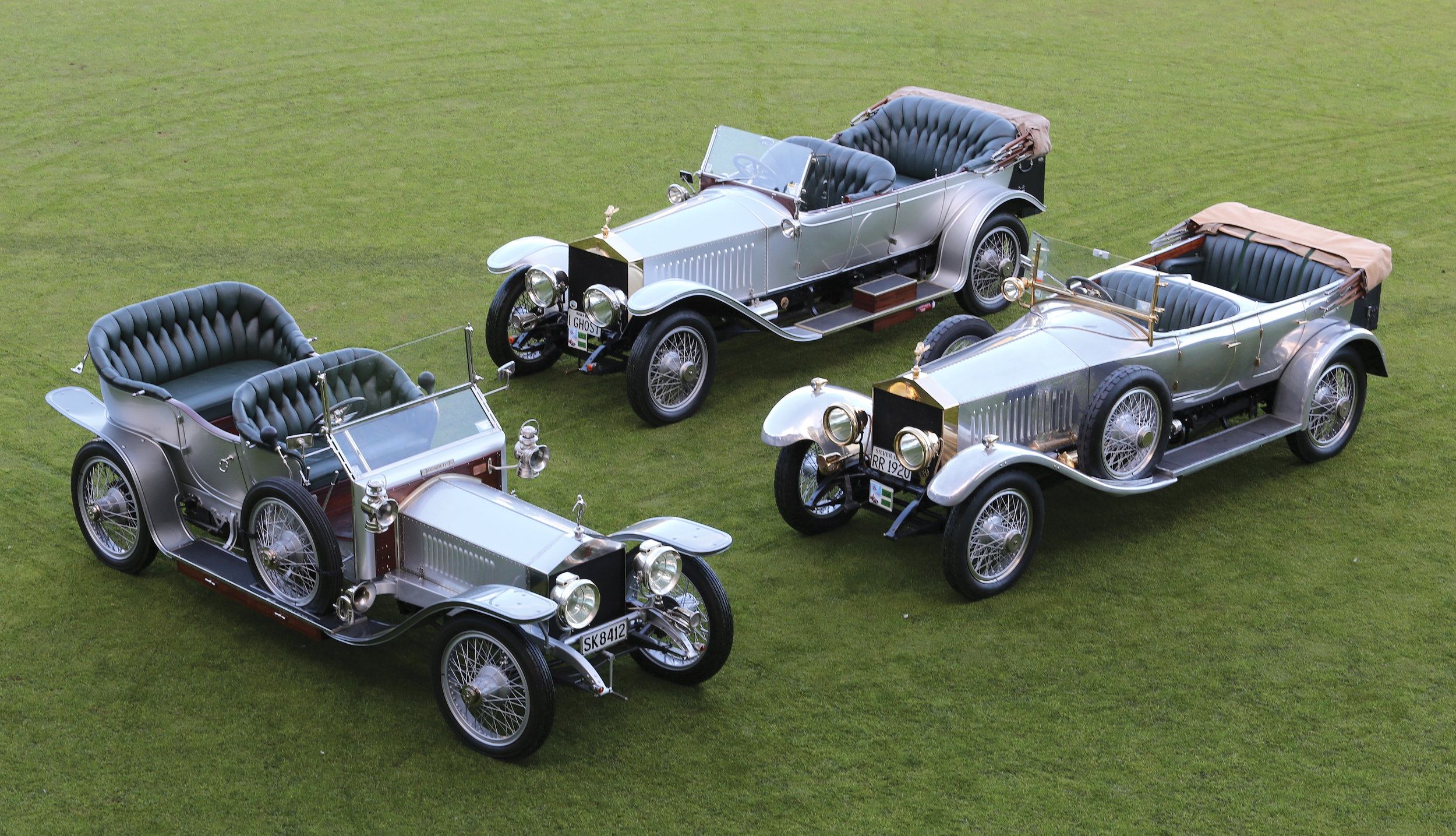 On show in their full glory, the three Silver Ghost Rolls-Royces—on the left is the 1908 model, once a wreck dumped in the Australian outback; at the rear is a 1914 model, built for the family of the Russian Tsar; and at right is a 1920 model, made for an English major for 2000 pounds.