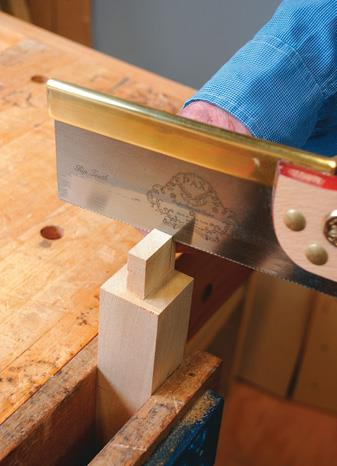 Trimming the side of the tenons by hand.