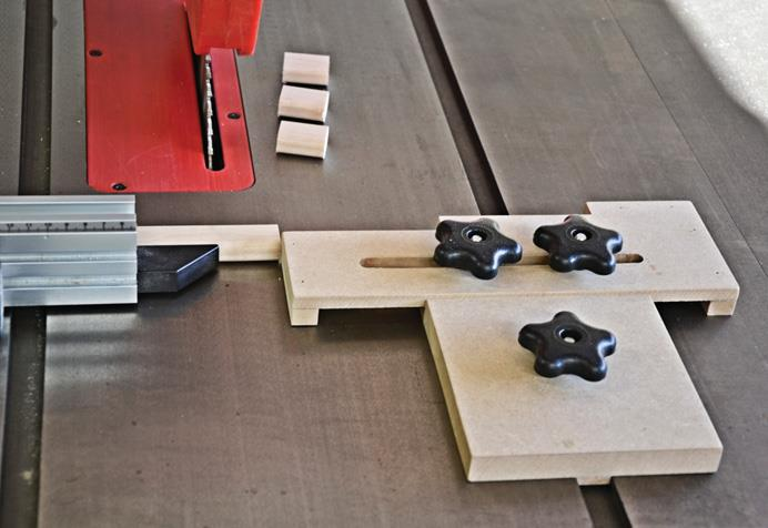Jig slides in T slot and is secured by plastic knobs.