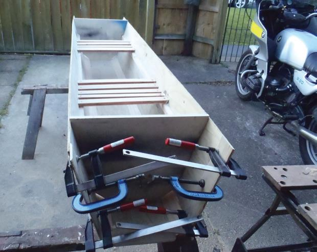 Doubler for joining is clamped while glue dries. Seat slats are glued and screwed, then dowelled, to long cleats. Temporary customwood frame is screwed in place at each end.