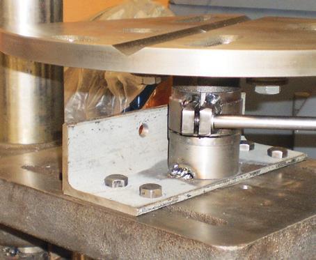 … on steel sleeve (split for clamping) welded to steel plate