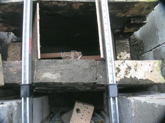 Looking down into smoke chamber. Tied wood pieces break apart for pulling the ply spacer out after the concrete has set.