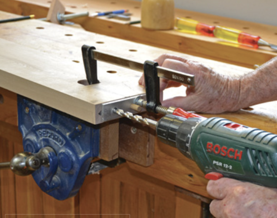 Drilling dowel holes in the side rail.