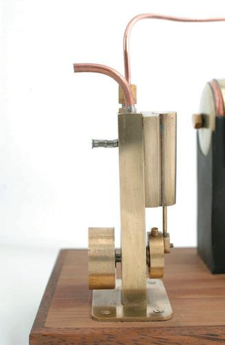 ..and sides.  The spring over the screw provides tension to keep the mating surfaces in contact.