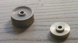 Flywheel (left) and crank wheel.