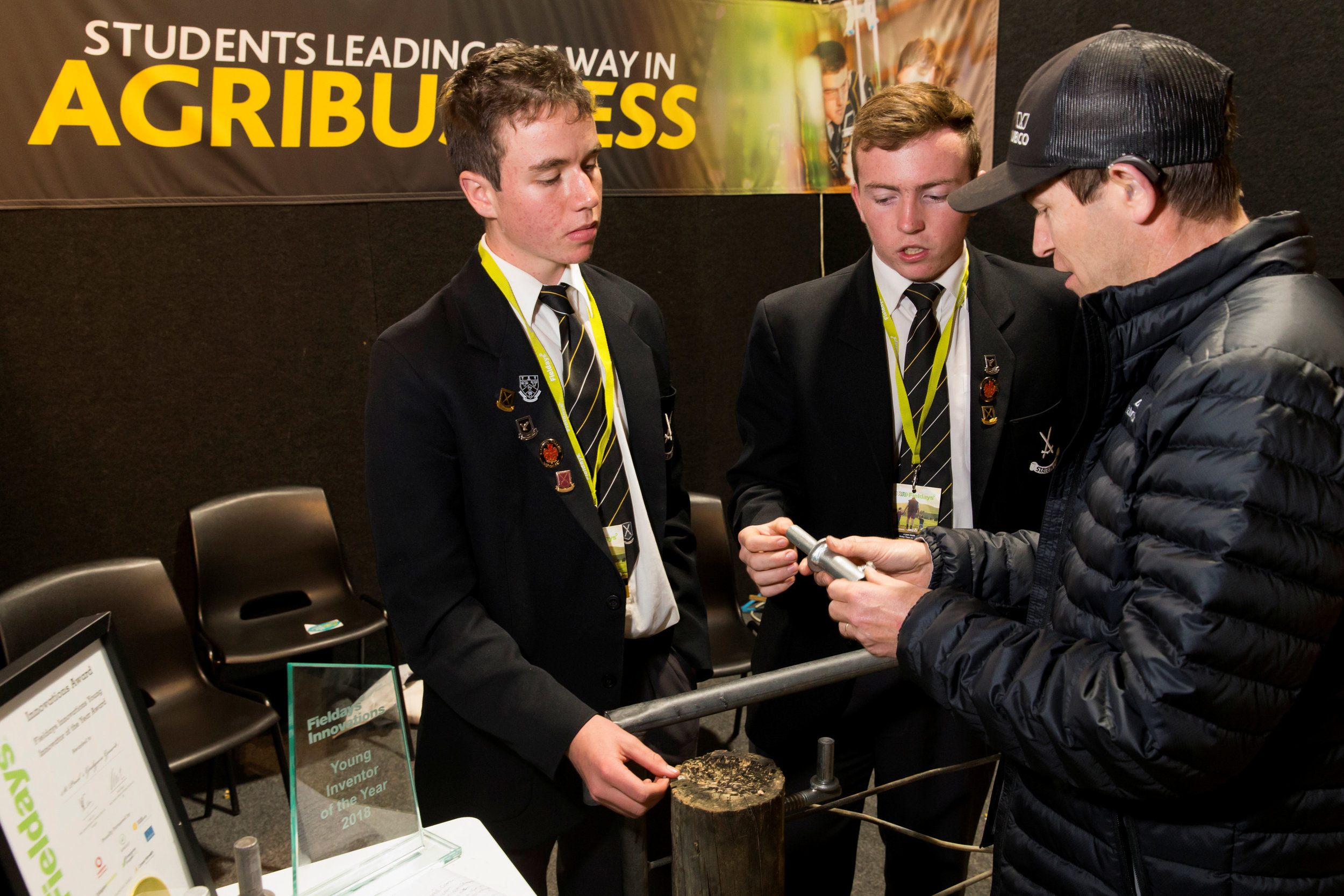 Students from St Paul's Collegiate talking with Fieldays visitors on their invention – the Gudgeon Guard