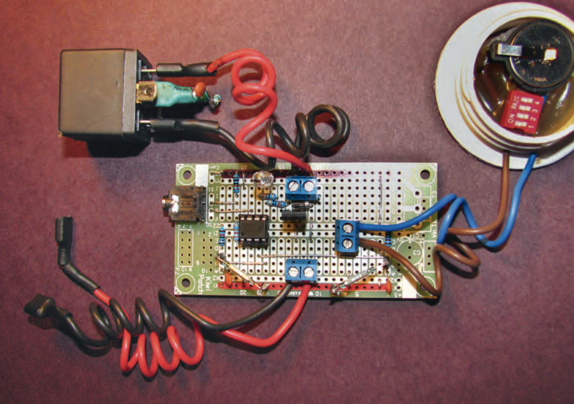 Timer assembly showing automotive relay with snubber (top left) and 3 v lithium battery with switch (top right).