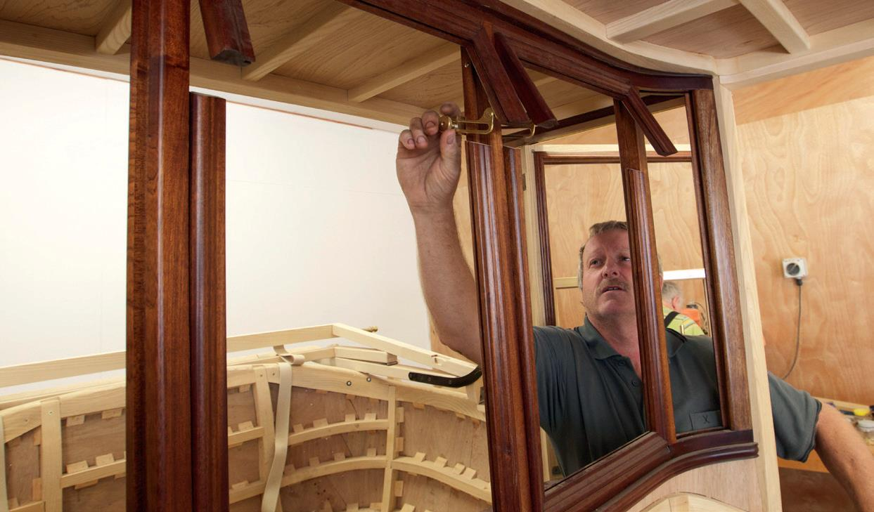 Neil shows hand-made latches for the vent windows between the driver and passengers.