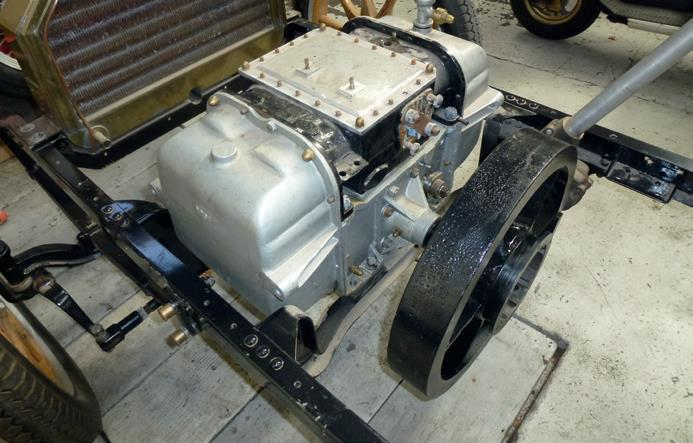 The unusual 113-year-old engine of the Arrol Johnston car—two cylinders and four pistons. Two pistons on each side oppose the other pair like a Boxer engine with one crankshaft and two cylinder heads at opposite ends.