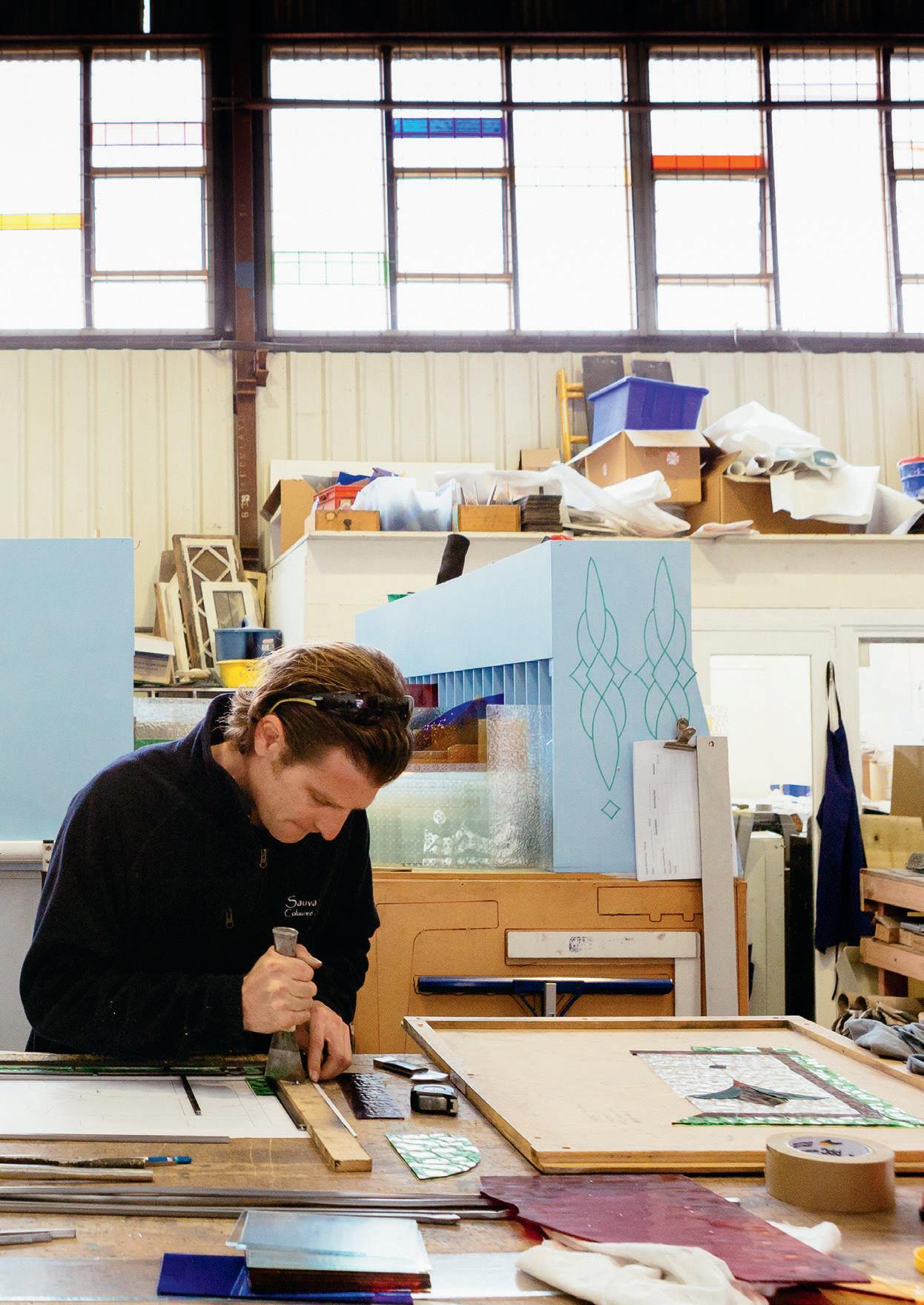 Myke Bakker at work at Sauvarins Coloured Glass Studio.
