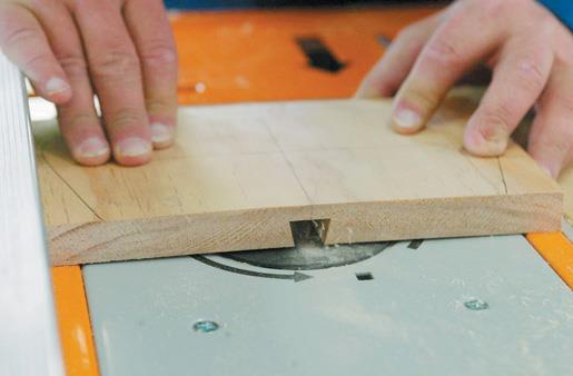 Cutting the sliding dovetail in the seatback before shaping it.