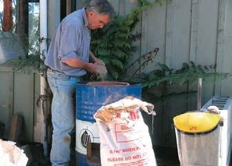 Robin Overall fills gap with vermiculite.