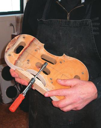 Ribs clamped with C bout block.