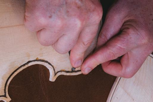 Purfling pick pushes inlay down.