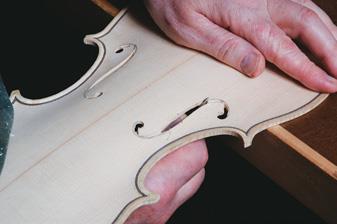 Cutting f-holes.