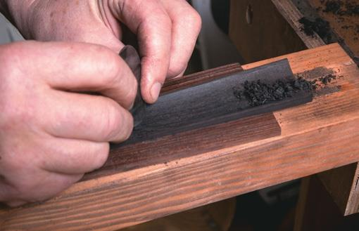 Scraping inside of fingerboard.
