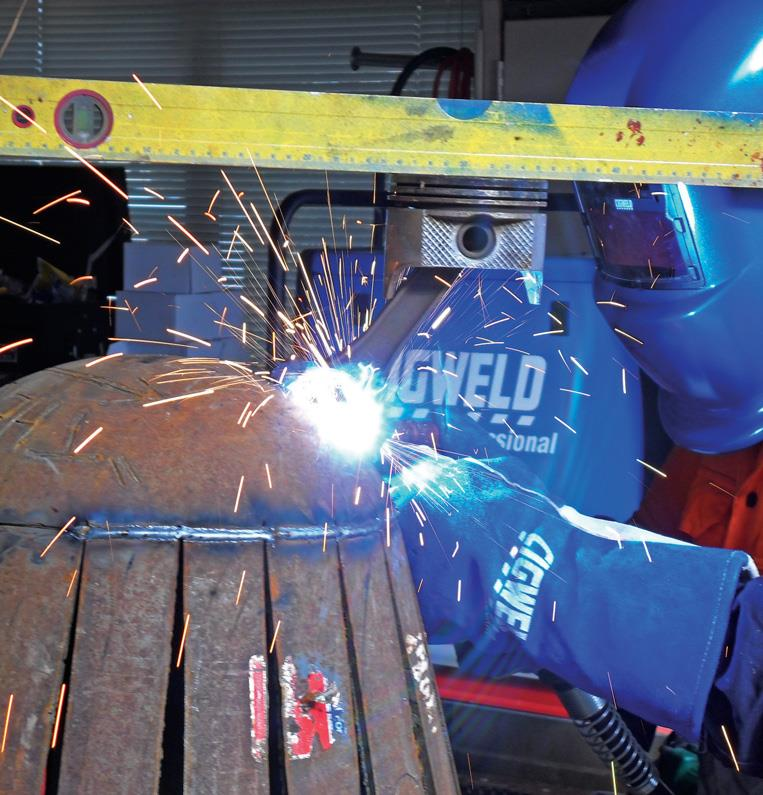 """Welding con rod on as feet. Level prevents """"wonky"""" setting."""