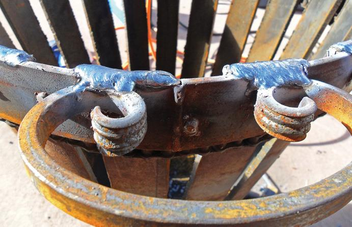 "Bulky welding holds ""curlies"" as handles."