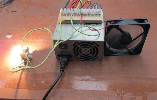 """Smoke Test""—switch on and see what smokes. Old headlamp bulb is connected between black (common) and yellow (+12v) wires. Load (fan) is spinning."