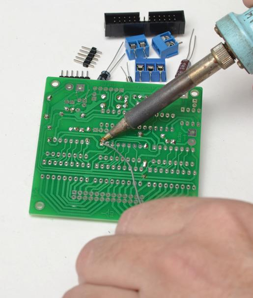 Soldering integrated circuit (IC) sockets.