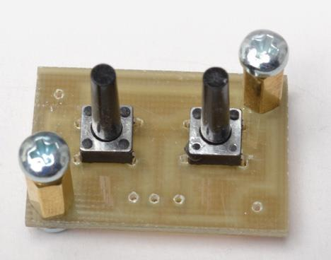 ...assembled for soldering (push buttons set the time)...