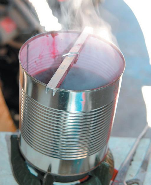 Boil dye for ten minutes, suspend spoon in it for 30 minutes.