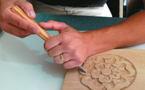 Ambidextrous: Right-handed (carver working from the right)...