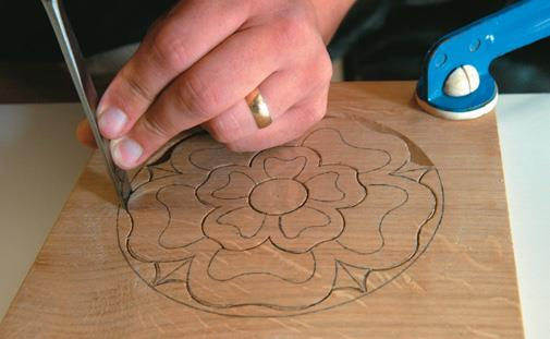 Using pinch position, set in outside perimeter of large and small petals and inner circle. Note work fixed to bench