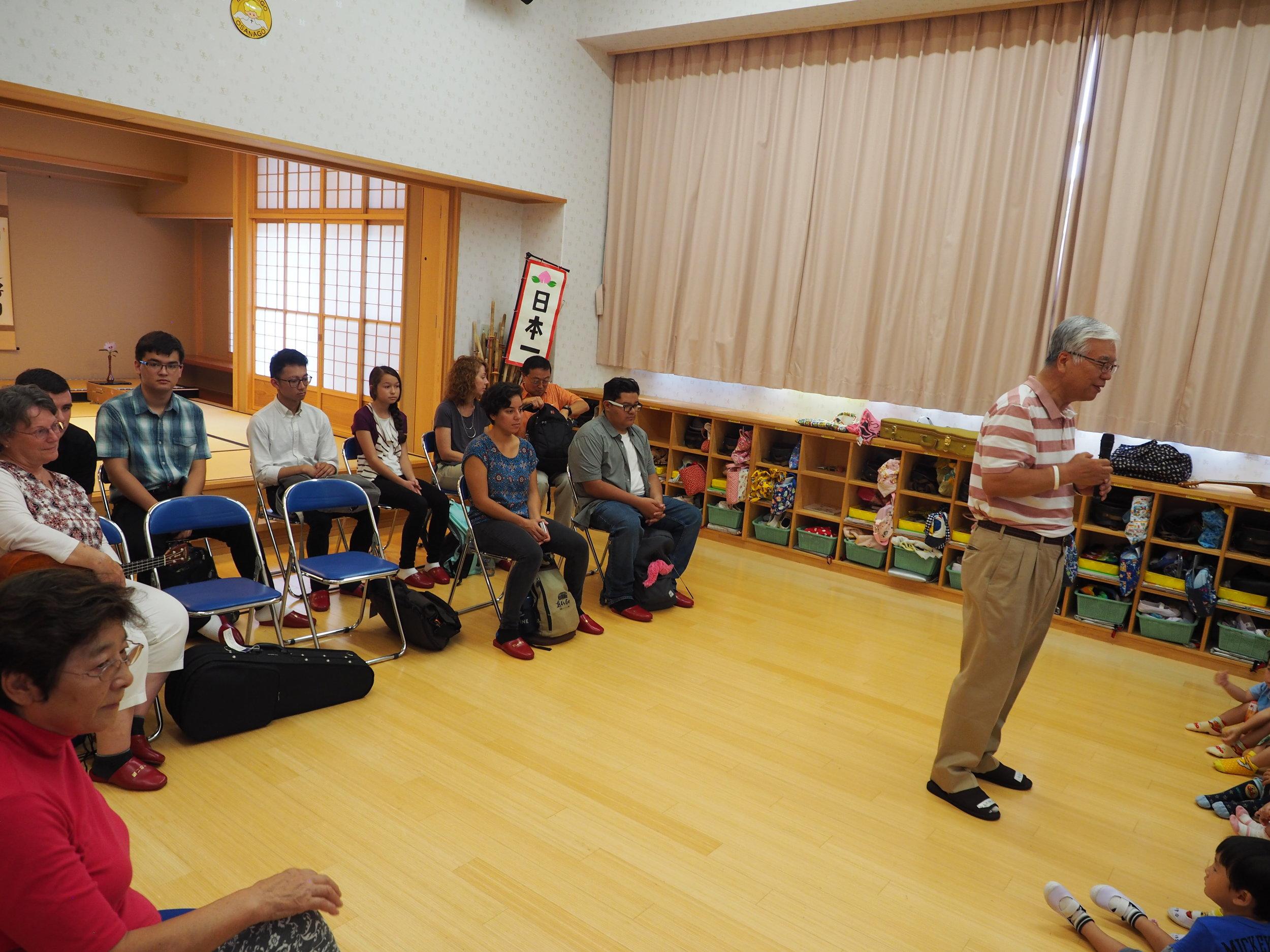 Pastor Kaz sharing with children