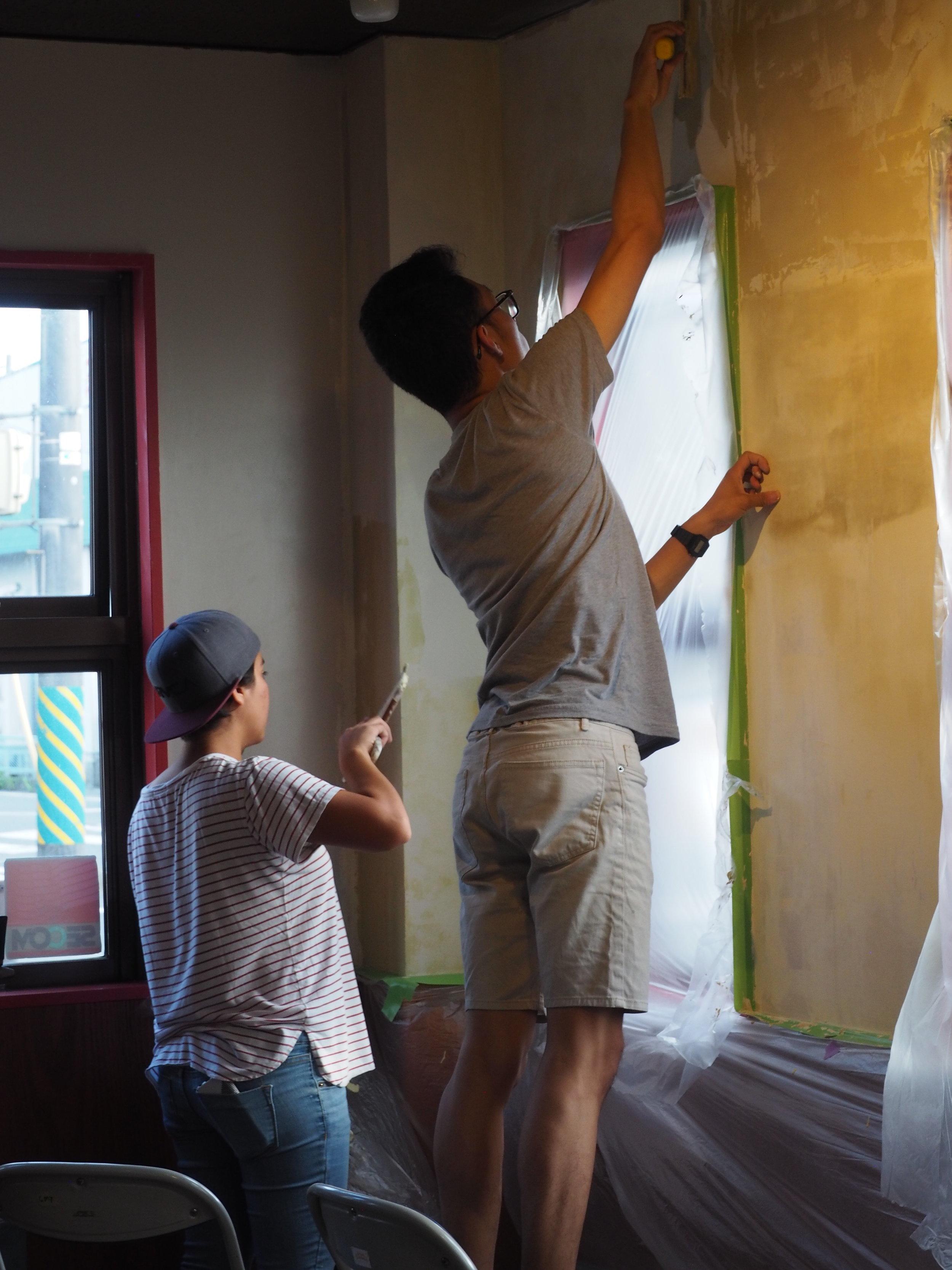 Hannah & Nick preparing walls for painting