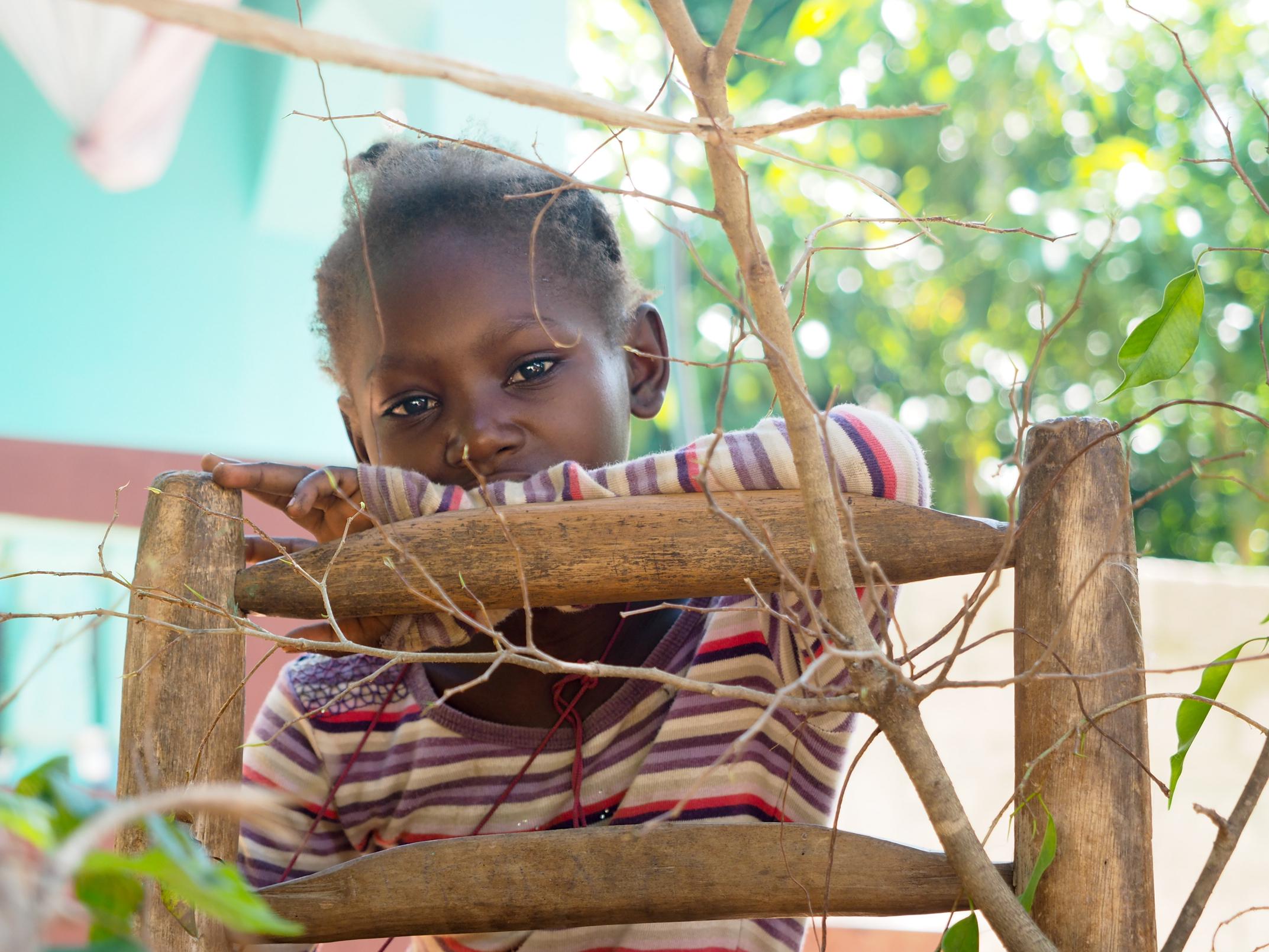Little girl outside her home, Cite Soleil