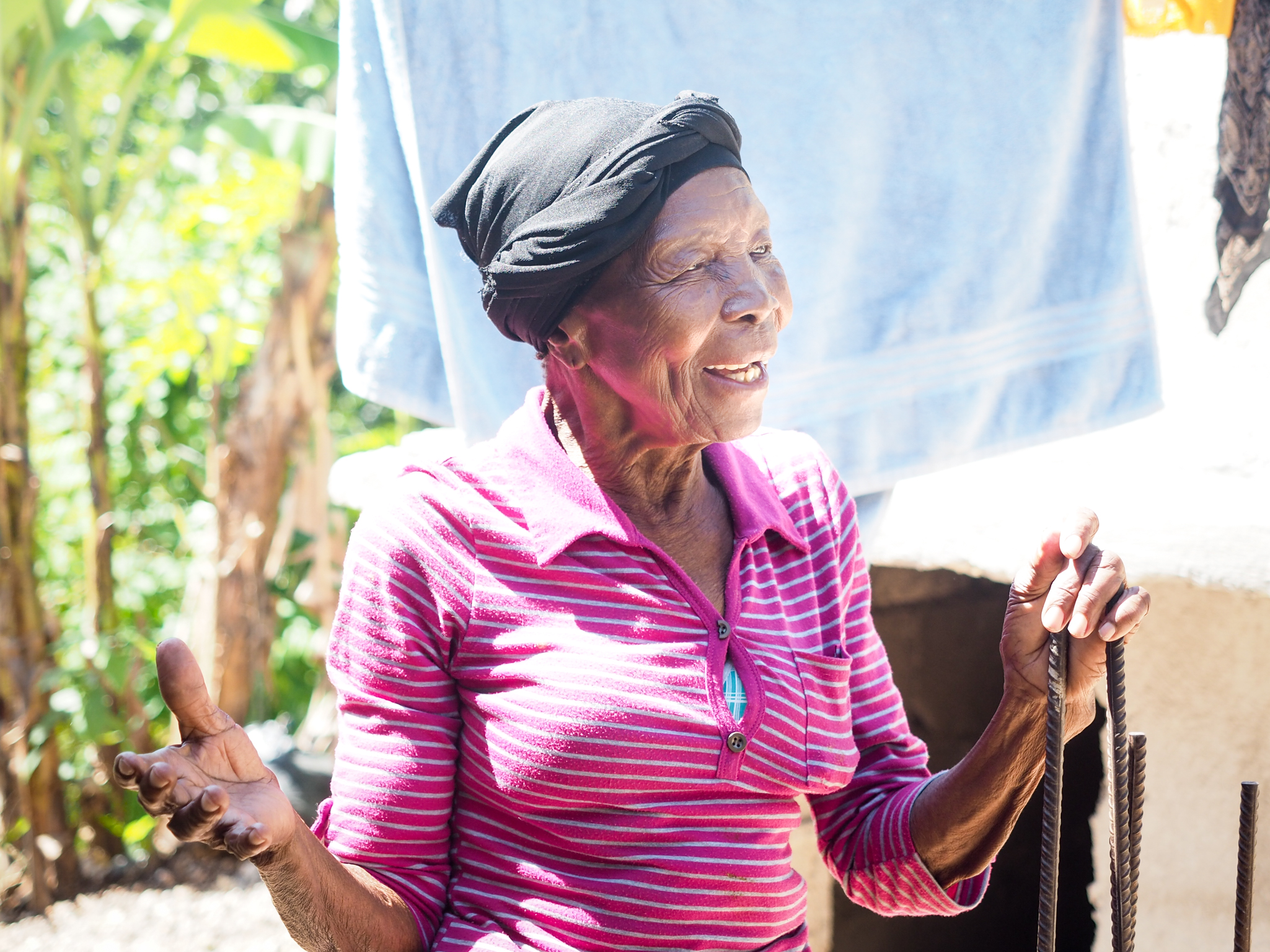 Elderly woman singing worship, Cite Soleil