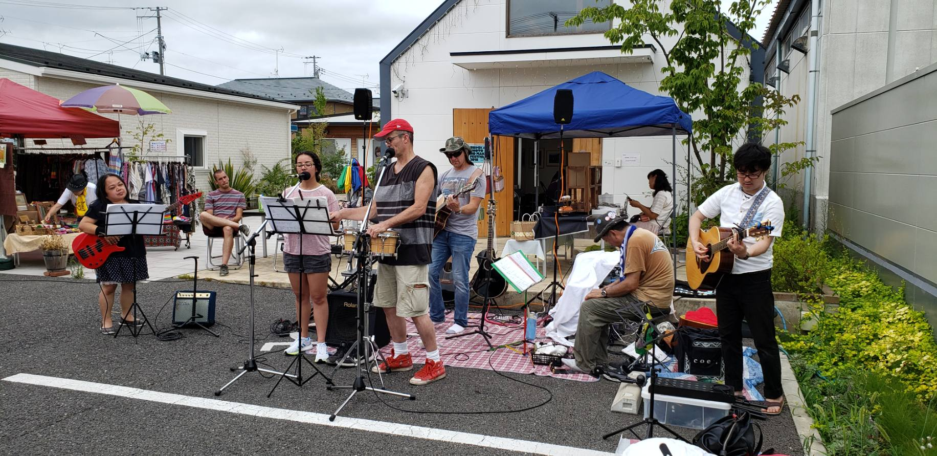 (Left to Right) missionary Cherry, Hannah, misssionary Rich, pastor Billy (with hat) then on the left two Japanese young men that were playing music before the team arrived who joined them.