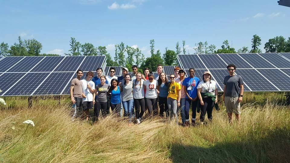 Students through ESSYI gathering by the colleges' solar farm.