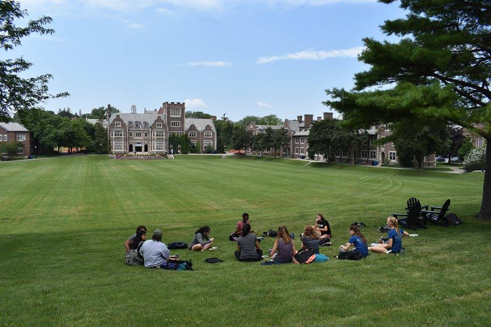 Students at Hobart and William Smith Colleges through ESSYI sitting on the quad during down time