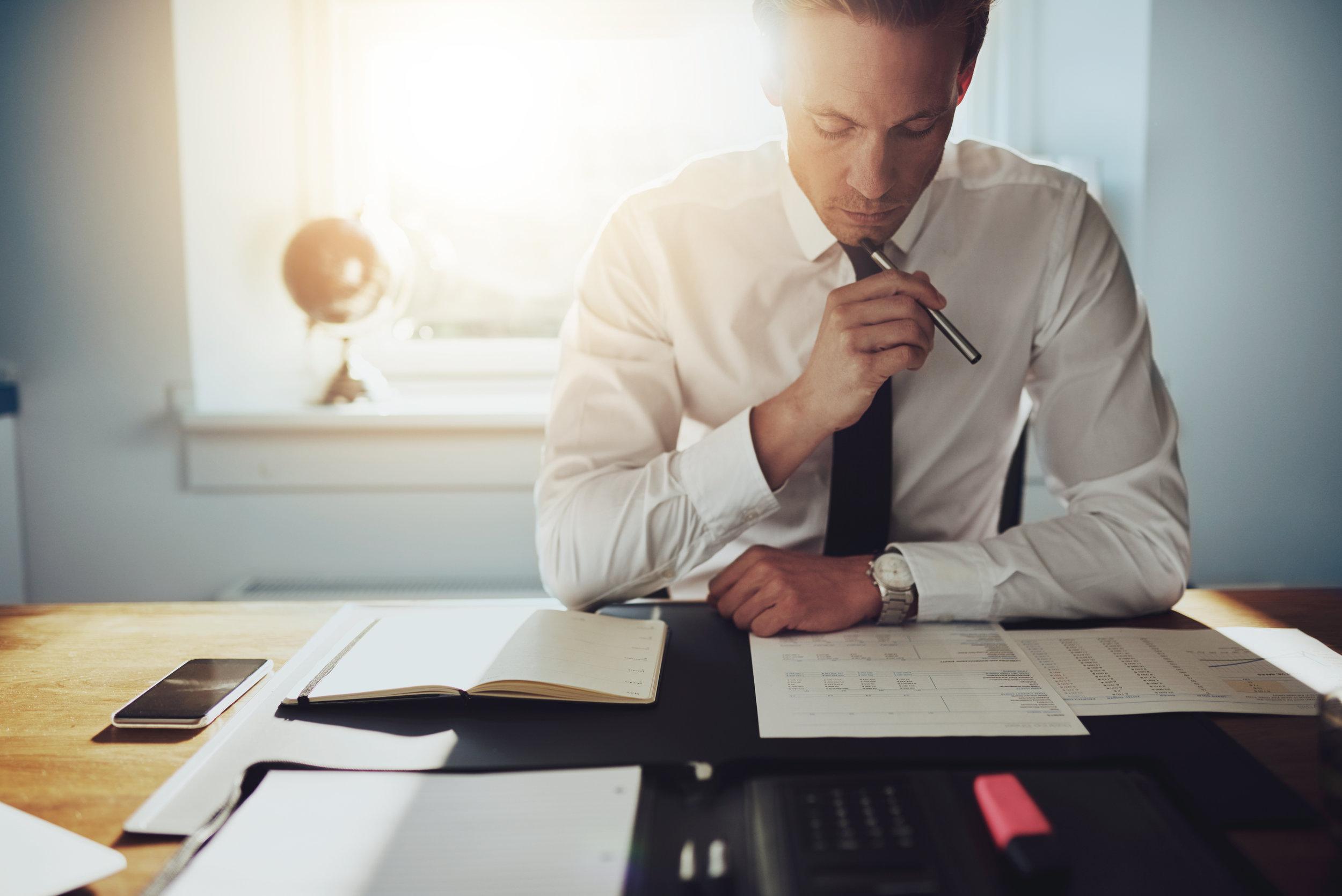 male lawyer thinking and writing.jpeg