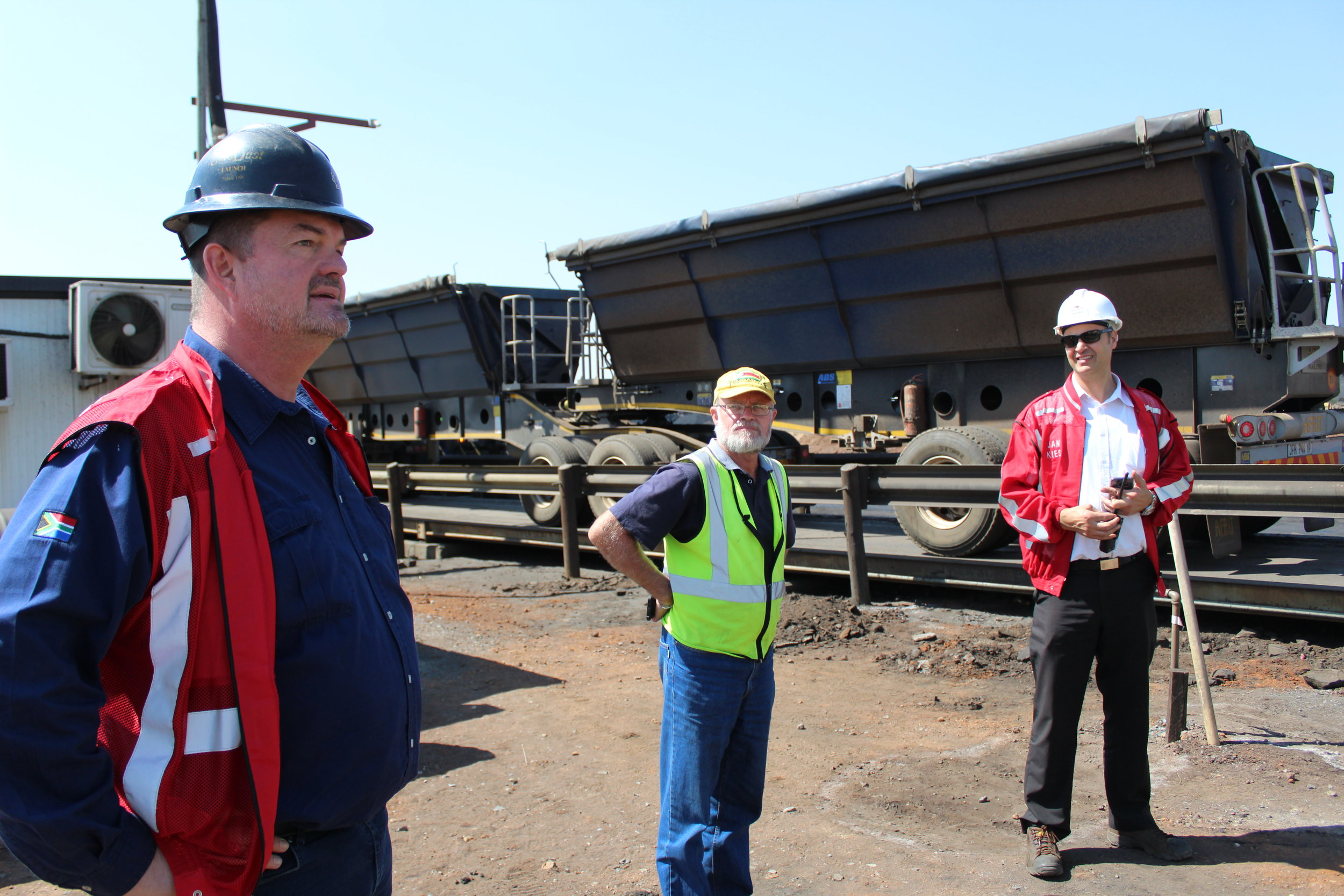 GM Alan Mabbett, Weighbridge Manager Naas Neveling, and Security Manager Jan Kies started the tour with a brief explanation of safety and security protocols as coal is transported out the mine by trucks at the weighbridge.