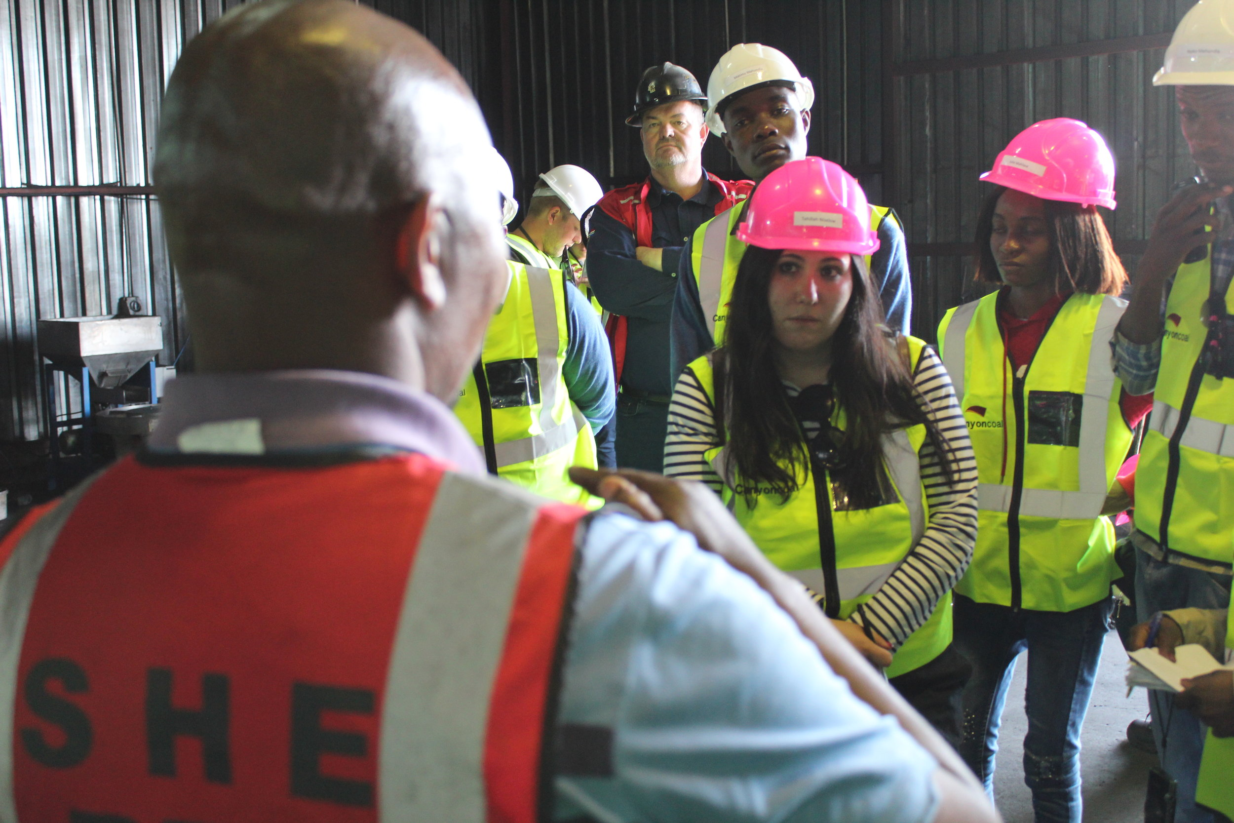 Lab Supervisor Piet Motoang answers questions about coal quality analysis from journalists, as GM Alan Mabbett looks on.