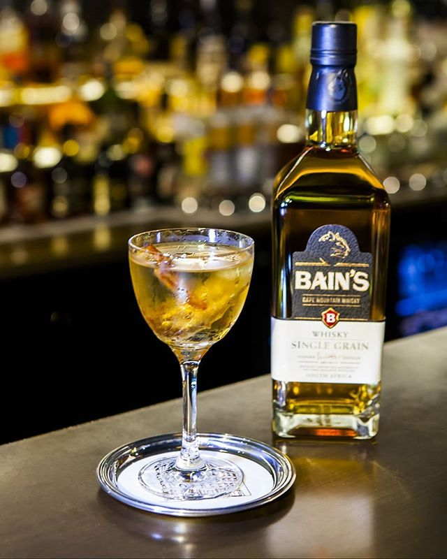 The South African inspired Golden Eye. Masterfully created by @cistoch and drawing on the South African heritage of Bain's and Whitley Neil, you can find this on the cocktail menu at @12hayhill  40ml @bainswhiskyuk 15ml Whitley Neil Gin 15ml Kumquat 10ml Tio Pepe Sherry  Method: Pre chill a coupe glass. Pour all the ingredients into a mixing glass over plenty of ice and stir well. Strain into the glass and garnish with a dried orange slice and a sprig of cinnamon.