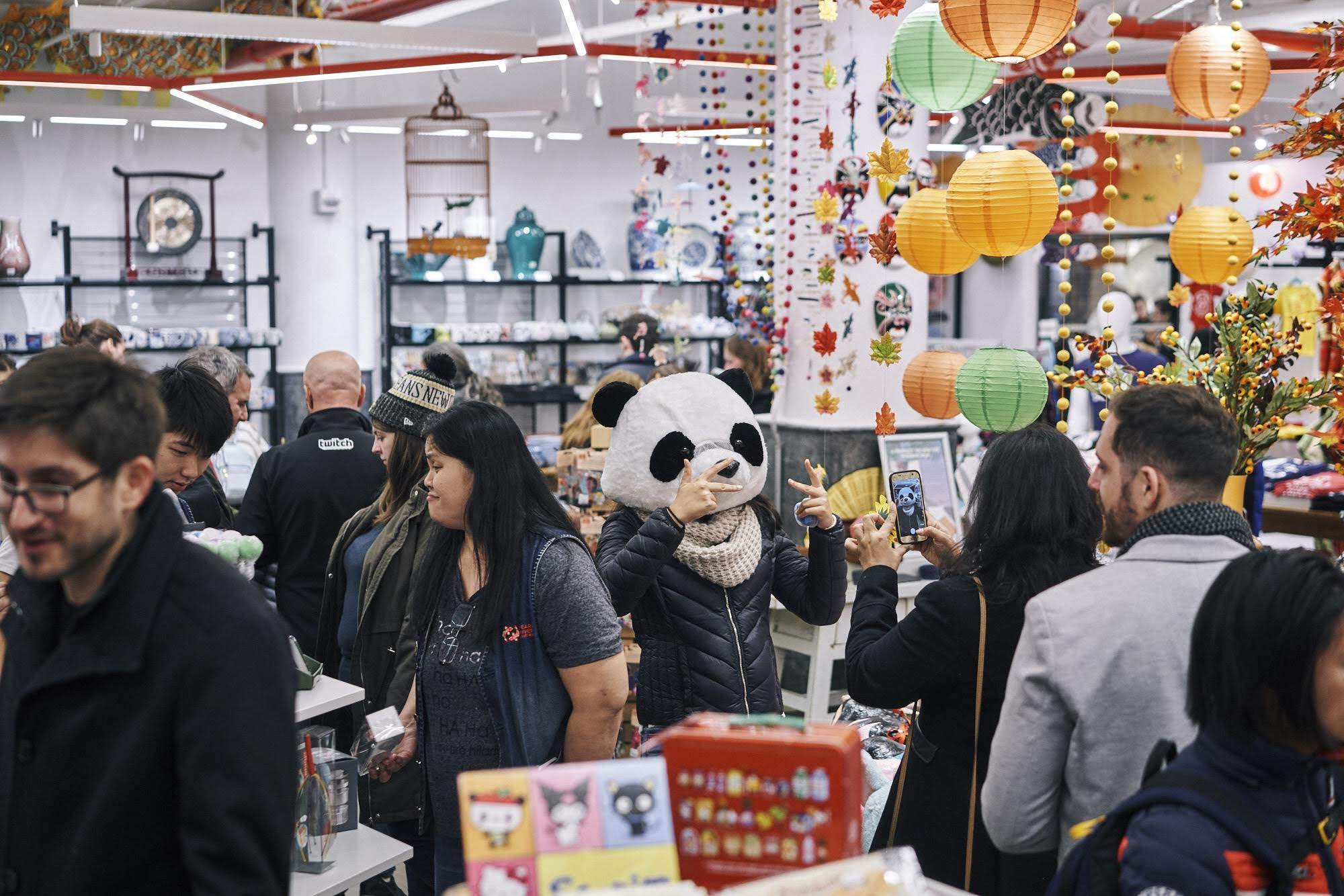 A typical -- and very crowded -- Saturday afternoon in the Chelsea Market store, complete with panda head pics.