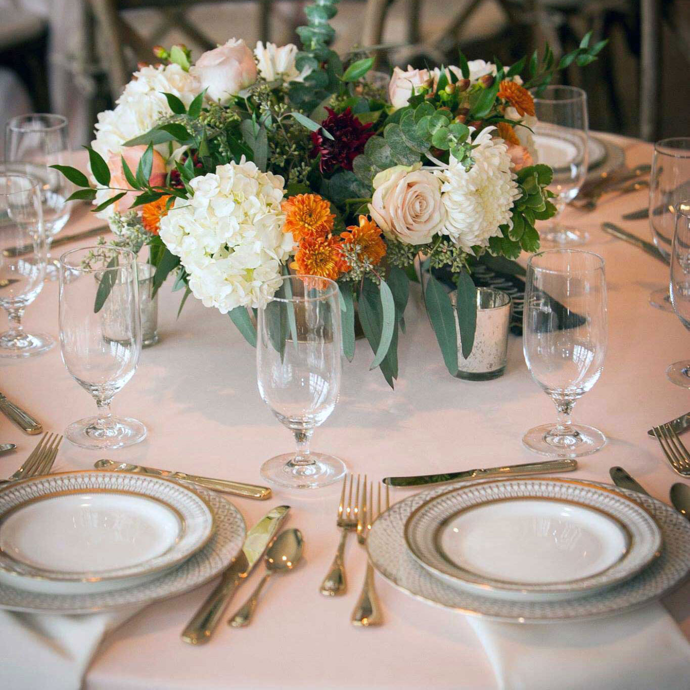 Tableware and florals at the Scott and Robin Shay wedding.
