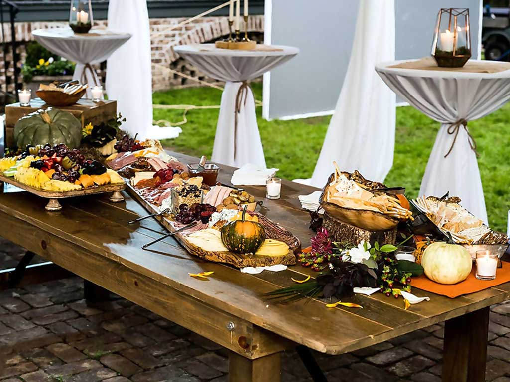 Farm table food spread at the Pearls to Pluff Mud Event at Swamp Fox Farms in Hardeeville, SC.