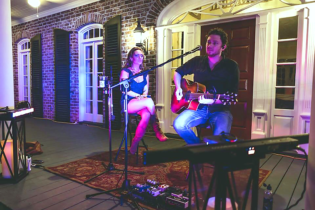 Musicians on the porch at the Pearls to Pluff Mud Event at Swamp Fox Farms in Hardeeville, SC.