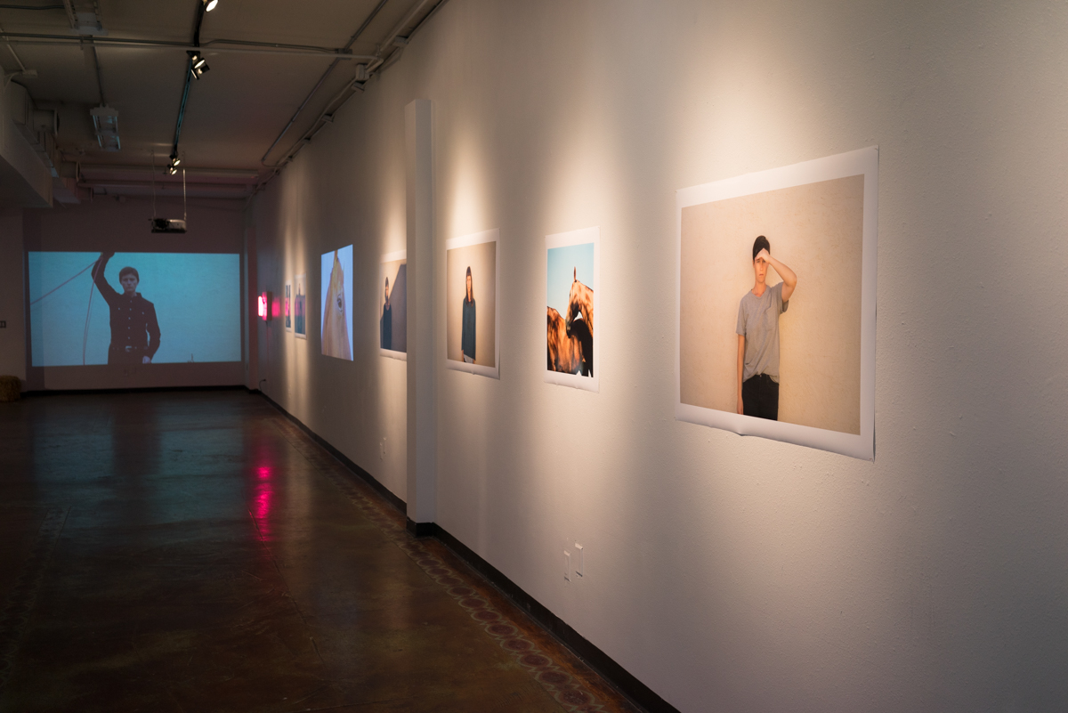 Installation view of long wall in main gallery