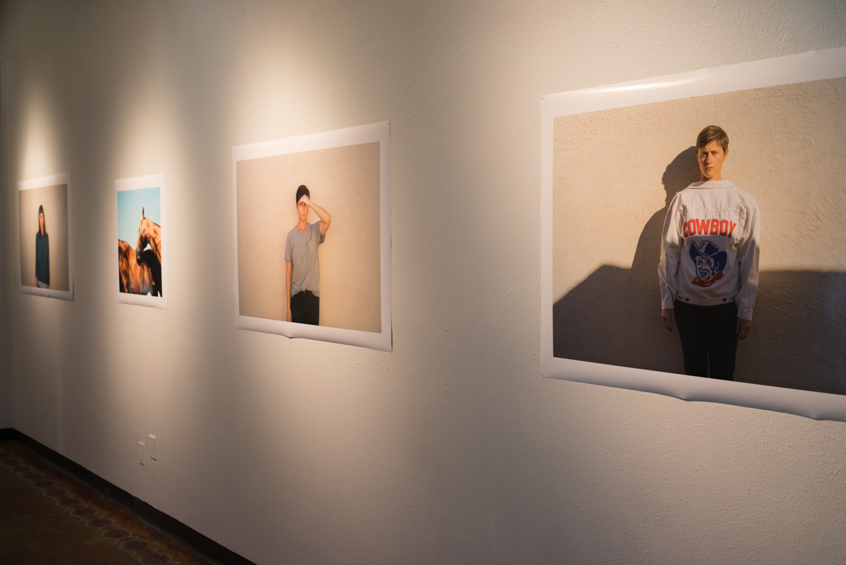 Installation view of long wall in main gallery, prints 40x30 inches and 22x22 inches
