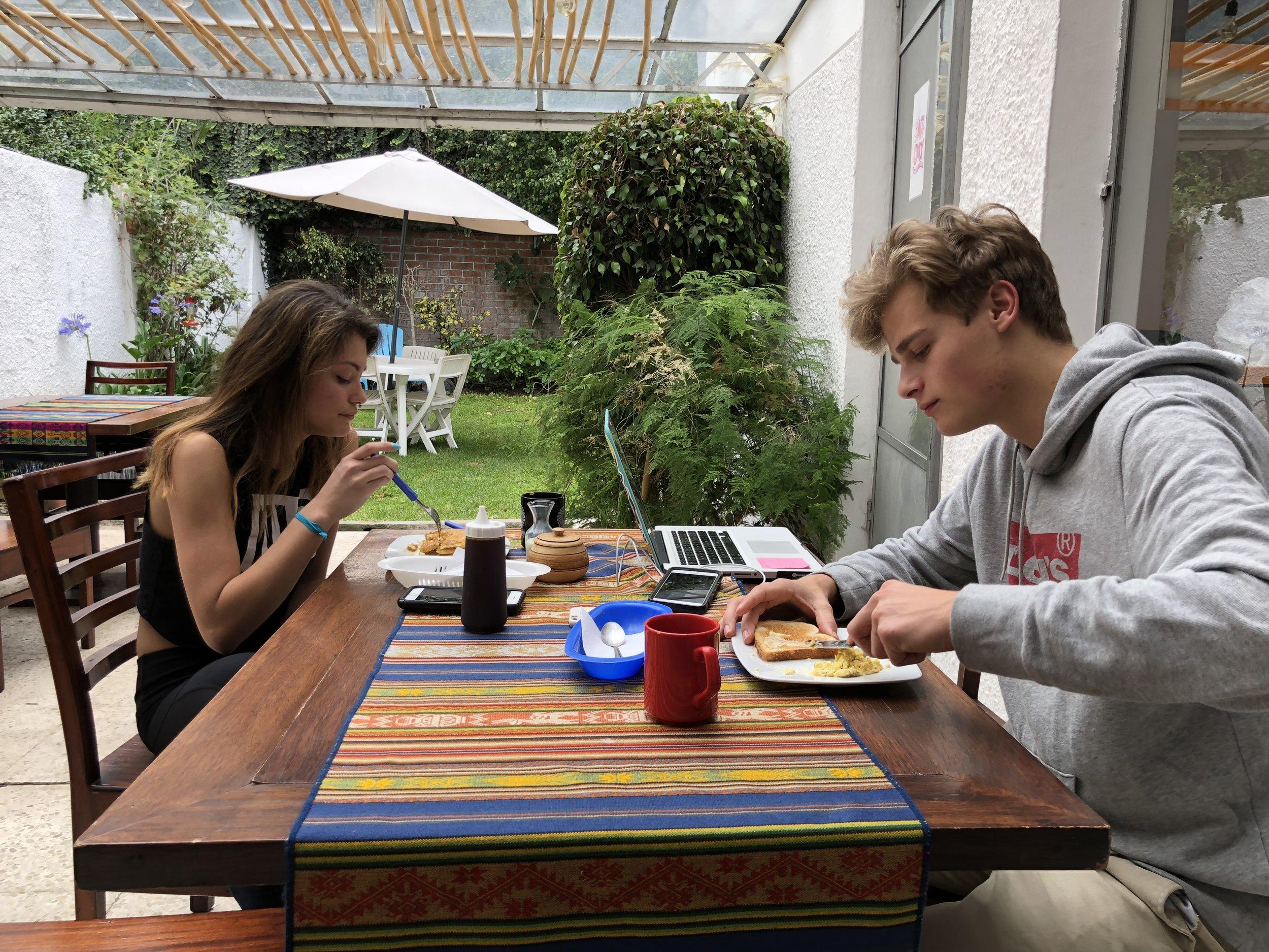 Kjetil and Amanda eating breakfast in the hostel's backyard.