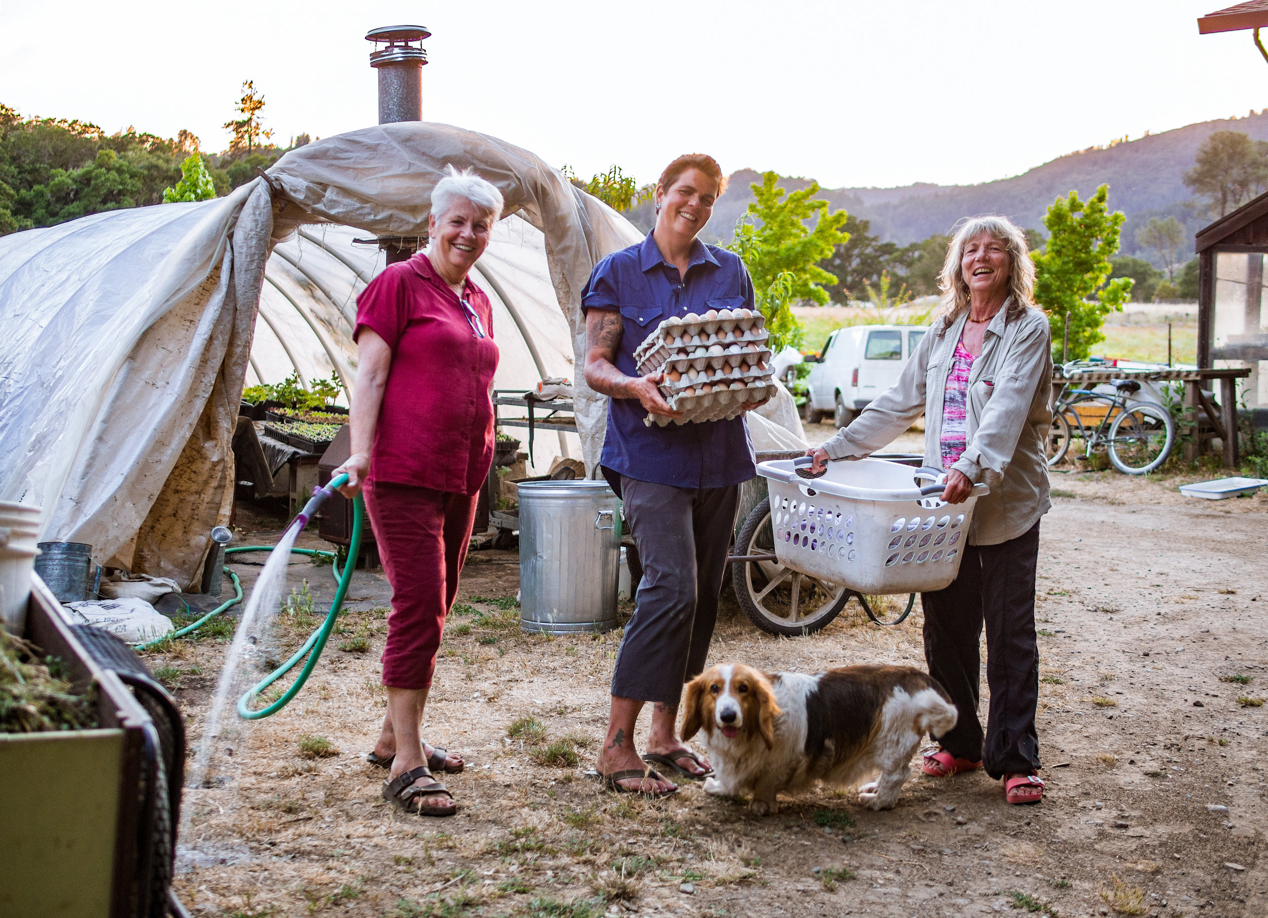 Tam, her daughter Kashaya, Lucy the masseuse, and Truckee the farm dog.
