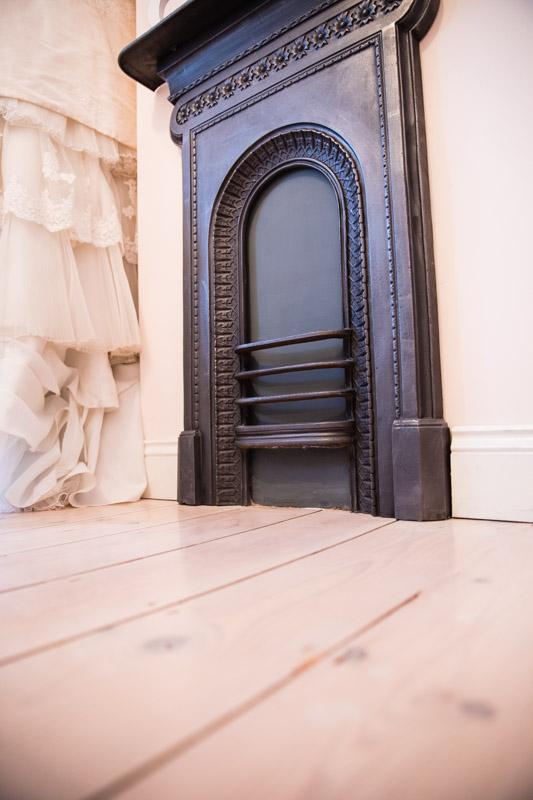 Wedding dress floor distressed cast iron fireplace